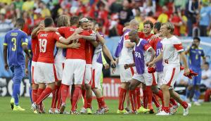 Swiss players celebrate after the group E World Cup…