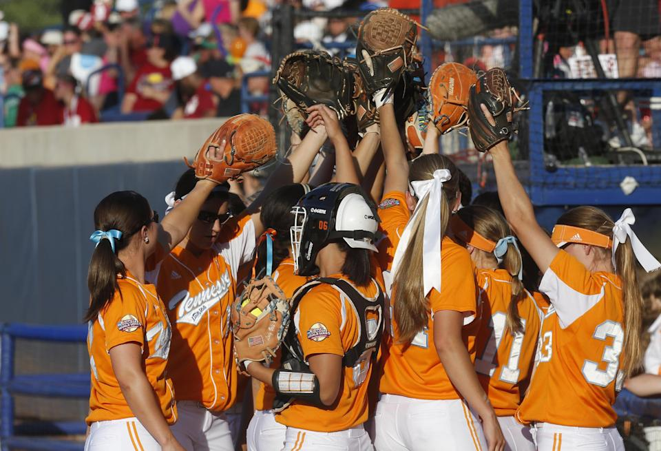 The Tennessee team gathers together before taking the field against Oklahoma in the first inning of the first game of the best of three Women's College World Series NCAA softball championship series in Oklahoma City, Monday, June 3, 2013. (AP Photo/Sue Ogrocki)
