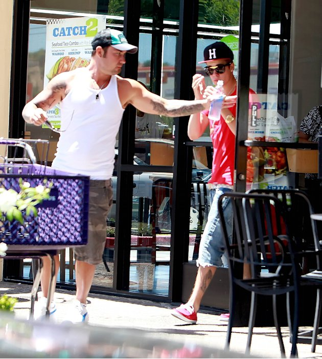 Justin Bieberleaving a fast food Mexican cuisine restaurant with a friendLos Angeles, California - 28.07.12Mandatory credit: PAP101/WENN.com