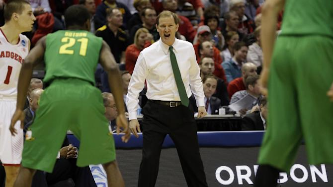 Oregon head coach Dana Altman directs his team during the first half of a third-round game against the Wisconsin of the NCAA college basketball tournament Saturday, March 22, 2014, in Milwaukee. (AP Photo/Jeffrey Phelps)