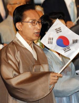 South Korean President Lee Myung-bak waves a national flag during a ceremony to celebrate Korean Liberation Day from Japanese colonial rule in 1945, in Seoul, South Korea, Monday, Aug. 15, 2011. (AP Photo/Lee Jae-won, Pool)