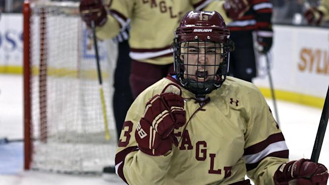 Boston College forward Johnny Gaudreau pumps his fist as he celebrates his goal against Northeastern goalie Chris Rawlings during the second period of the championship game at the Beanpot college hockey tournament in Boston, Monday, Feb. 11, 2013.  (AP Photo/Charles Krupa)