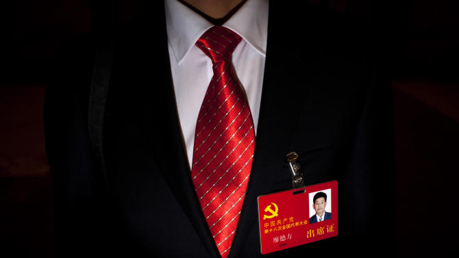 In this Nov. 9, 2012 photo, Liao Defang, a delegate of China's 18th Communist Party Congress, poses for a photo after a group discussion meeting at the Great Hall of the People in Beijing. Along with government officials, managers of state industries and military officers, delegates of the 18th Communist Party Congress also include migrant workers, peasants, factory technicians, teachers, doctors, artists and Olympic gold medalists. Many of the rank and file delegates are brought to Beijing to make the roughly 2,300-member congress more representative, and have no real political clout. They ratify decisions made by a few dozen party insiders in backroom deals. Still, they believe in the cause and swoon at the prestige of being chosen to be a national delegate. (AP Photo/Alexander F. Yuan)