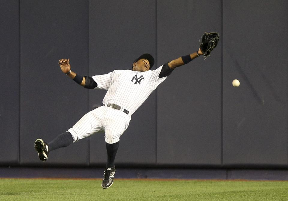 New York Yankees' Curtis Granderson can't catch a triple hit by Boston Red Sox's Pedro Ciriaco during the ninth inning of the baseball game at Yankee Stadium in New York, Saturday, July 28, 2012. The Red Sox beat the Yankees 8-6. (AP Photo/Seth Wenig)