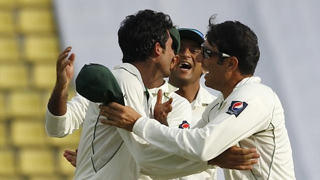 Pakistan's captain Misbah-ul-Haq (R) and Junaid Khan (L) celebrate (Reuters)