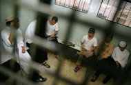 Alleged Muslim militants sit in a cell at South Jakarta detention centre in 2007. Indonesian police on Wednesday shot dead one suspected militant, arrested two others and seized bombs during a raid in a central district that is considered a hotbed of terrorism