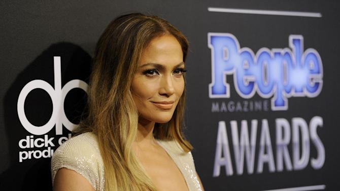 Jennifer Lopez arrives at The People Magazine Awards at the Beverly Hilton hotel on Thursday, Dec. 18, 2014, in Beverly Hills, Calif. (Photo by Chris Pizzello/Invision/AP)