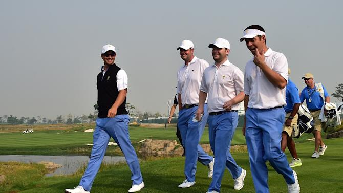 International Team player Adam Scott (L) walks with team members Marc Leishman (2nd L),  Branden Grace (2nd R) and Louis Oosthuizen (R) on the 10th hole during a practice session ahead of the 2015 Presidents Cup in Incheo on October 7, 2015