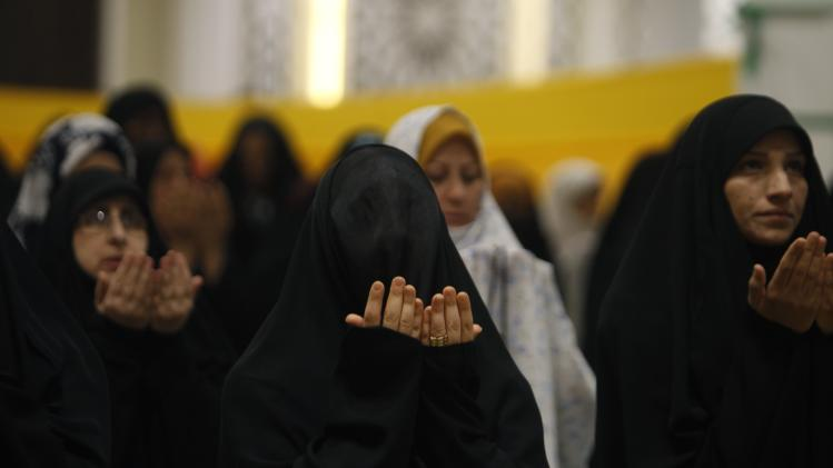 Shi'ite women attend prayers for Eid al-Fitr as they mark the end of the fasting month of Ramadan, in Baghdad