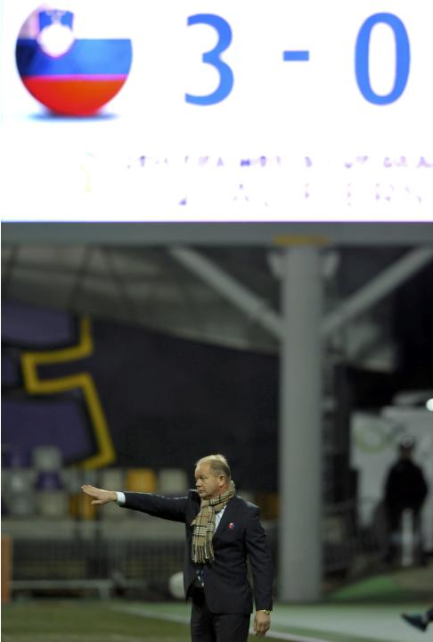 Norway's coach Hogmo reacts under the score board during the World Cup 2014 qualifier soccer match against Slovenia in Maribor