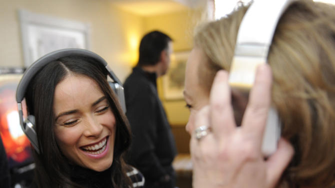 Abigail Spencer, left, and J. Smith-Cameron wear Inspiration headphones by Monster products at the Fender Music lodge during the Sundance Film Festival on Friday, Jan. 18, 2013, in Park City, Utah. (Photo by Jack Dempsey/Invision for Fender/AP Images)