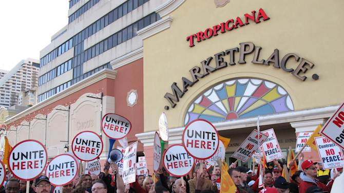 In this April 5, 2012, photo, casino workers stage a protest outside the Tropicana Casino and Resort in Atlantic City, N.J. The Unite-HERE casino workers are protesting the lack of a contract and the termination of employee pension accounts. (AP Photo/Wayne Parry)