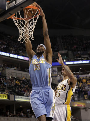 Denver Nuggets forward Corey Brewer, left, dunks in front of Indiana Pacers forward Gerald Green during the first half of an NBA basketball game in Indianapolis, Friday, Dec. 7, 2012. (AP Photo/AJ Mast)