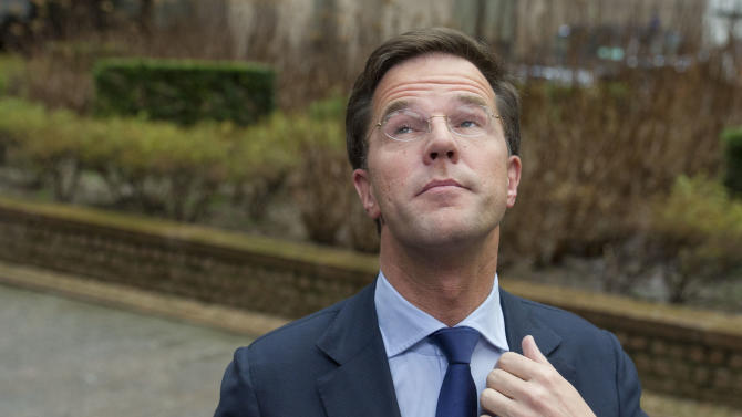 Dutch Prime Minister Mark Rutte looks up, as he arrives during an EU Budget summit at the European Council building in Brussels, Thursday, Feb. 7, 2013. European Union leaders braced for all-night negotiations in Brussels to try and strike a deal on EU spending for the next seven years, especially after the summit start was delayed by hours. (AP Photo/Geert Vanden Wijngaert)