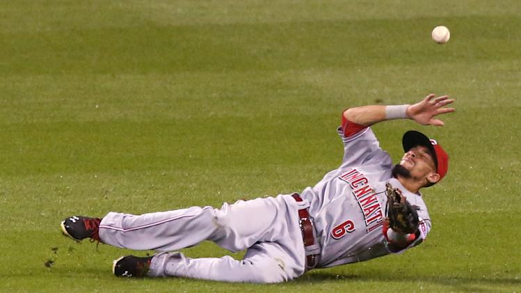 Cincinnati Reds center fielder Billy Hamilton is unable to catch a line-drive double by St. Louis Cardinals' Peter Bourjos in the eighth inning of a baseball game Wednesday, Aug. 20, 2014, at Busch Stadium in St. Louis. (AP Photo/St. Louis Post-Dispatch, Chris Lee)