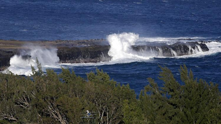Waves crash as seen from the course before the first round at the Tournament of Champions PGA golf tournament, Sunday, Jan. 6, 2013, in Kapalua, Hawaii. Play was to have started two days earlier, but was delayed because of rain and high winds. (AP Photo/Elaine Thompson)