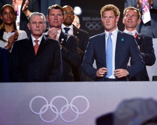 Britain's Prince Harry (R) attends the closing ceremonies for the London 2012 Olympic Games on August 12. The British royal family said nude photographs of Prince Harry cavorting with friends on holiday in Las Vegas were genuine.