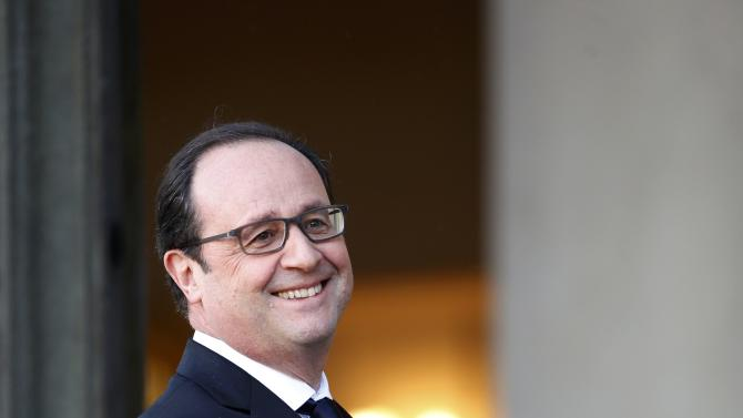 French President Francois Hollande walks back to his office after a meeting with Zambia's President Edgar Lungu at the Elysee Palace in Paris