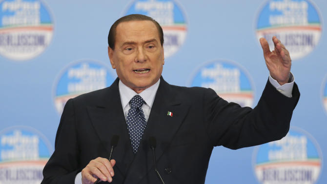 Former Italian Premier Silvio Berlusconi delivers his speech at a gathering of supporters in Milan, Italy, Sunday, Feb. 3, 2013. Berlusconi is promising Italians if they vote him back into office that he will not only abolish an unpopular tax on primary residences, but he'll refund property taxes Premier Mario Monti's government made them pay in 2012. Berlusconi abolished the tax when last elected premier in 2008, but Monti, who replaced him in 2011 as Italy sunk into the Eurozone debt crisis, revived it to help fill state coffers. (AP Photo/Antonio Calanni)