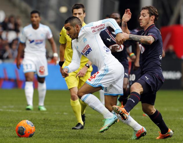 Olympique Marseille's Payet challenges Bordeaux's Tsafack during their French Ligue 1 soccer match at the Velodrome stadium in Marseille