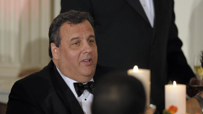 New Jersey Gov. Chris Christie joins other governors of the National Governors Association at the 2013 Governors' Dinner at the White House in Washington, Sunday, Feb. 24, 2013. (AP Photo/Susan Walsh)
