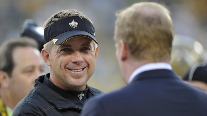 FILE - In this Sept. 8, 2011 file photo, NFL commissioner Roger Goodell shakes hands with New Orleans Saints head coach Sean Payton before an NFL football game against the Green Bay Packers in Green Bay, Wis. Goodell has reinstated Payton following a season-long suspension for his role in the team's bounty scandal. The announcement comes Tuesday, Jan. 22, 2013, a day after Payton met with Goodell. (AP Photo/Jim Prisching, File)