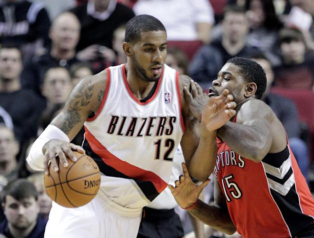 Portland Trail Blazers forward LaMarcus Aldridge, left, drives on Toronto Raptors forward Amir Johnson during the first half of an NBA basketball game in Portland, Ore., Saturday, Feb. 1, 2014
