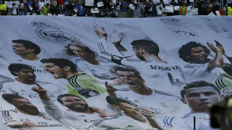 Real Madrid fans hold up a banner during the Champion's League semi-final first leg soccer match against Bayern Munich in Madrid