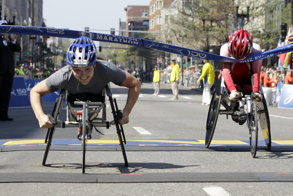 Women's wheelchair winner Shirley Reilly of the United States, left, crosses  the finish line ahead of second-place finisher Wakako Tsuchida of Japan in the 2012 Boston Marathon in Boston, Monday, April 16, 2012. (AP Photo/Elise Amendola)