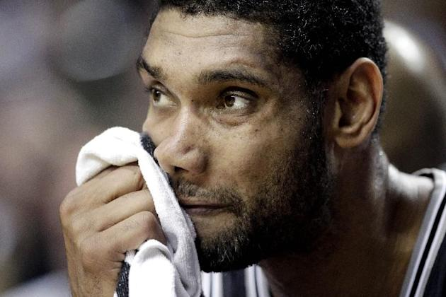 San Antonio Spurs forward Tim Duncan watches from the bench during the second half of an NBA basketball game against the Portland Trail Blazers in Portland, Ore., Saturday, Nov. 2, 2013. Portland defe