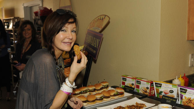 Actress Holly Fields eats gardein meatless products at the Fender Music lodge during the Sundance Film Festival on Monday, Jan. 21, 2013, in Park City, Utah. (Photo by Jack Dempsey/Invision for Fender/AP Images)
