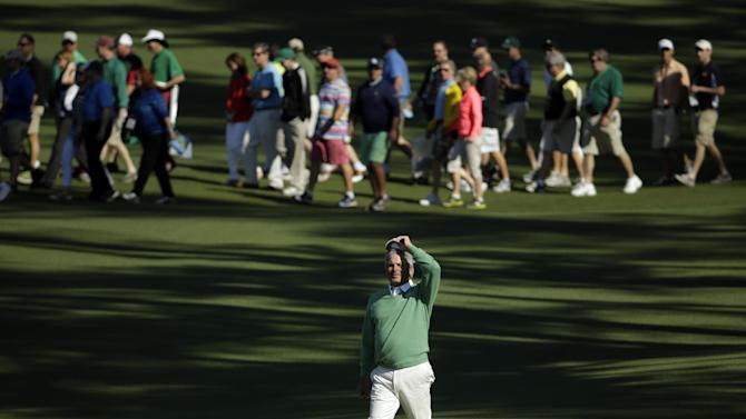 Fred Couples walks down the second fairway during the first round of the Masters golf tournament Thursday, April 10, 2014, in Augusta, Ga