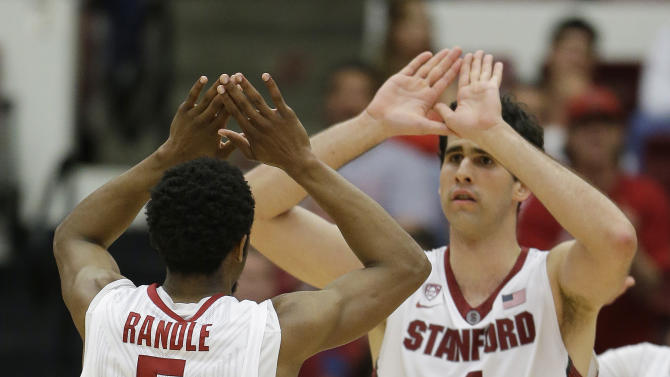 Stanford guard Chasson Randle, left, is greeted by teammate Stefan Nastic, right, after scoring in the second half of an NCAA college basketball game against Utah Saturday, March 8, 2014, in Stanford, Calif. Stanford won the game 61-60