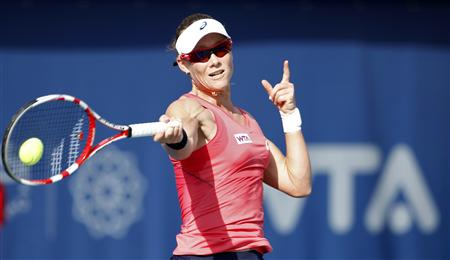 Stosur of Australia hits a return to Vinci of Italy during their women's singles quarter-final match at the WTA Dubai Tennis Championships
