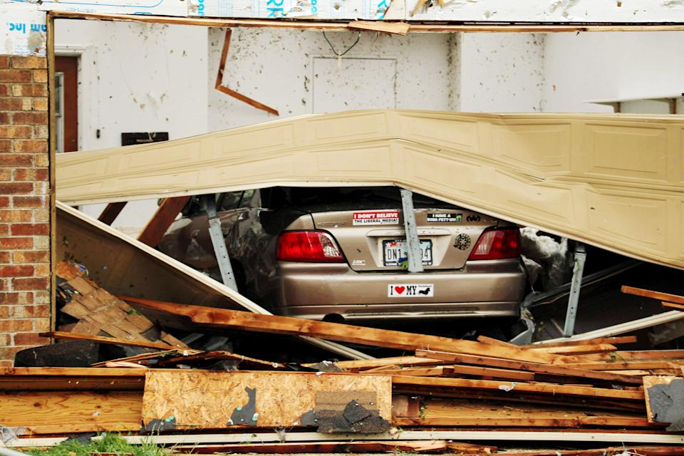A car is seen in a damaged home after Wednesday's tornado in Cleburne, Texas on Thursday, May 16, 2013. Ten tornadoes touched down in several small communities in Texas overnight, leaving at least six people dead, dozens injured and hundreds homeless. Emergency responders were still searching for missing people Thursday afternoon. (AP Photo/Ron Russek II)