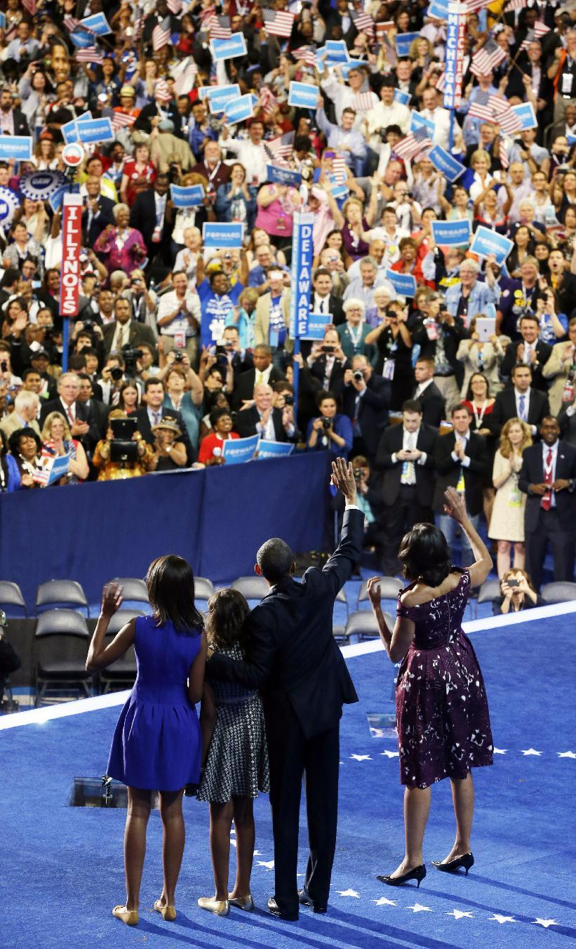President Barack Obama, first lady Michelle Obama, their children Malia and Sasha, wave on stage on the final day of the Democratic National Convention in Charlotte, N.C., Thursday, Sept. 6, 2012. (AP Photo/Pablo Martinez Monsivais)