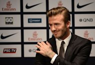 Former England captain David Beckham gives a press conference at the Parc des Princes stadium in Paris, on January 31, 2013, to announce that he joined the French football club Paris Saint-Germain (PSG).