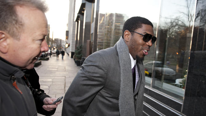 New Orleans Saints football linebacker Jonathan Vilma is pursued by reporters as he arrives at an attorney's office in Washington, Friday, Nov. 30, 2012, for a session of the pay-for-pain bounty system with the New Orleans Saints. Friday's session is part of the latest round of player appeals overseen by former NFL Commissioner Paul Tagliabue.  (AP Photo/Cliff Owen)