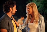 "In this image released by Universal Pictures, Thomas Ian Nicholas, left, and Tara Reid are shown in a scene from ""American Reunion"". (AP Photo/Universal Pictures, Hopper Stone)"