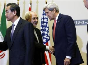 US Secretary of State Kerry shakes hands with Iranian…
