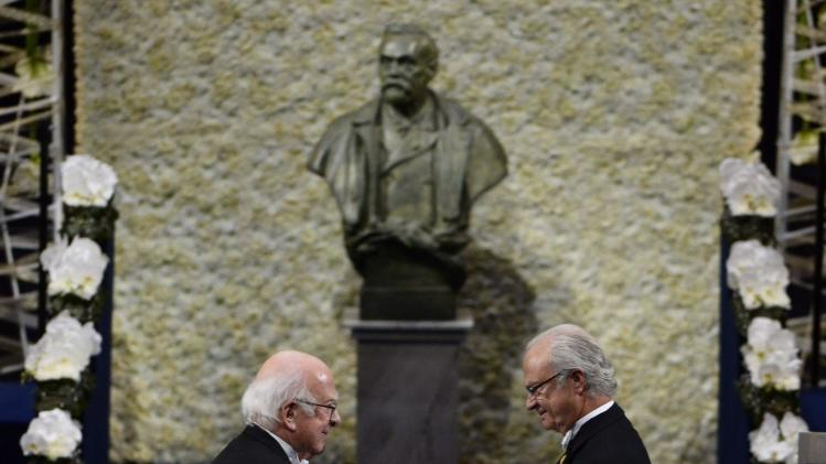 Peter Higgs receives his Nobel Prize in Physics from Sweden's King Carl Gustaf during the 2013 Nobel Prize award ceremony in Stockholm