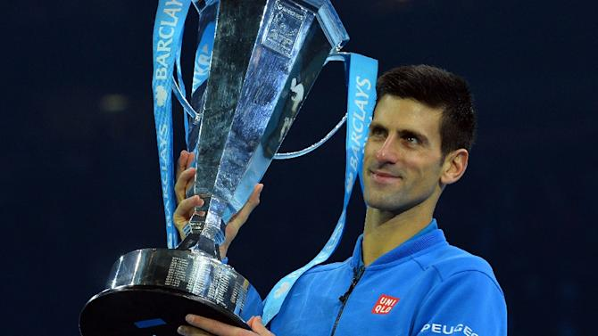 Serbia's Novak Djokovic, posing here with the ATP trophy in London on November 22, 2015, finished the year with a massive 7,500 points ahead of his closest rival