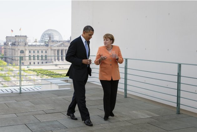 German Chancellor Merkel and U.S. President Obama speak on the terrace of the Chancellery in Berlin