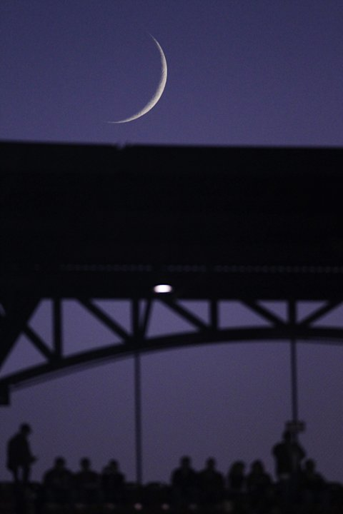 The moon is visible from Busch Stadium before Game 7 of baseball's World Series between the St. Louis Cardinals and the Texas Rangers Friday, Oct. 28, 2011, in St. Louis. (AP Photo/Jeff Roberson)