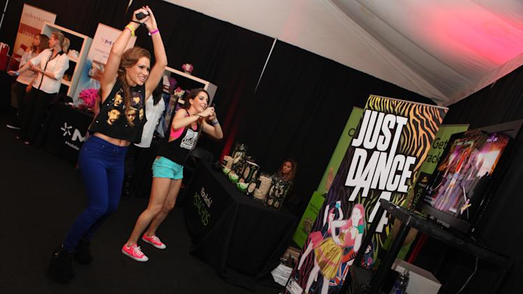 IMAGE DISTRIBUTED FOR UBISOFT - Kimberly Cole is seen at Ubisoft's Just Dance 4 and The Hip Hop Experience Gifting Suite at the American Music Awards at the Nokia Theater on Saturday Nov. 17, 2012 in Los Angeles. (Photo by Casey Rodgers/Invision for Ubisoft/AP Images)