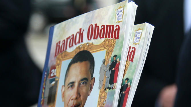 A Cub Scout holds items to be signed by President Barack Obama, Saturday, May 5, 2012 in Richmond, Va. (AP Photo/Haraz N. Ghanbari)