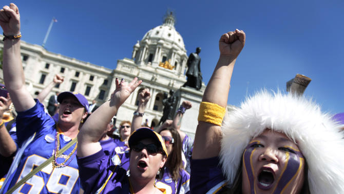 """Minnesota Vikings fan Erin Darsow, right, of Burnsville, Minn., attens a rally at the state Capitol in support of a new stadium for the NFL football team, Monday, May 7, 2012, in St. Paul, Minn. Supporters of a new Vikings stadium pleaded for votes in the Minnesota House on Monday, calling it their """"one chance"""" to preserve the team's future in the state. (AP Photo/Star Tribune, Jerry Holt) ST. PAUL OUT  MINNEAPOLIS-AREA TV OUT  MAGS OUT"""