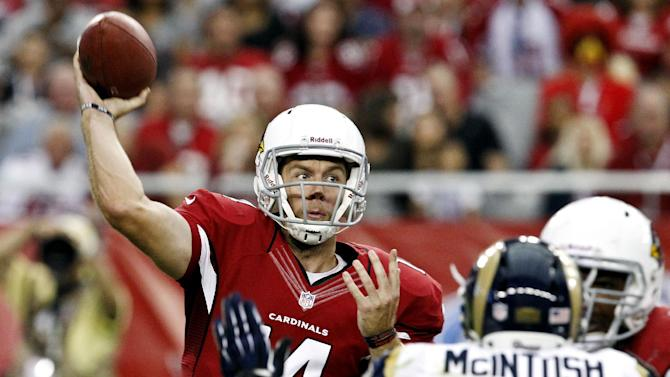 Arizona Cardinals' Ryan Lindley, left, gets off a pass as he is pressured by St. Louis Rams' Rocky McIntosh (50) in the first half of an NFL football game, Sunday, Nov. 25, 2012, in Glendale, Ariz. (AP Photo/Ross D. Franklin)