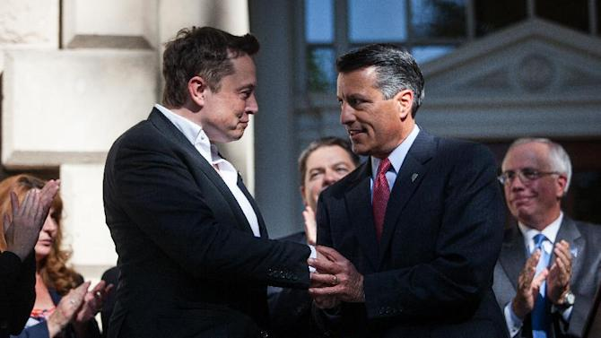 Elon Musk, CEO of Tesla Motors, is introduced by Governor Brian Sandoval of Nevada during a press conference at the Nevada State Capitol, September 4, 2014 in Carson City, Nevada