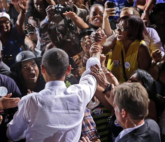 President Barack Obama, center, greets supporters after speaking at a campaign event in Desert Pines High School, Sunday, Sept. 30, 2012 in Las Vegas. (AP Photo/Pablo Martinez Monsivais)